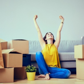 Woman next to the boxes of a moving house