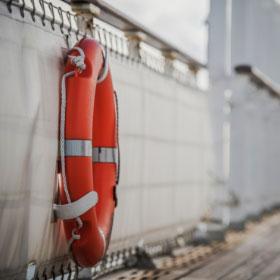 Lifeguard on railing